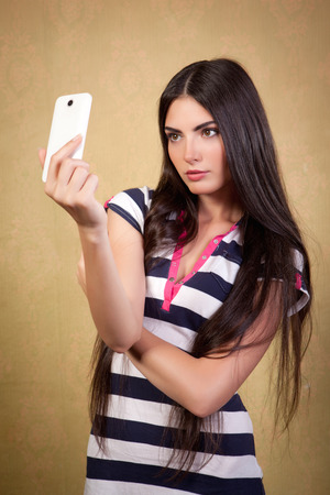 Pretty girl photographed themselves on a mobile camera  photo