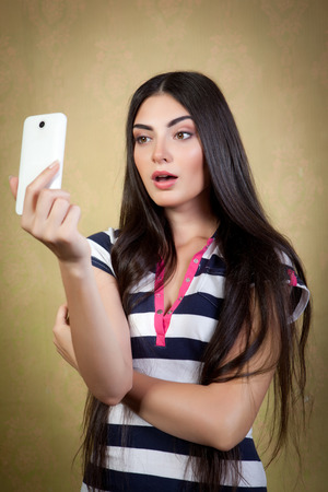 Pretty girl photographed themselves on a mobile camera. photo