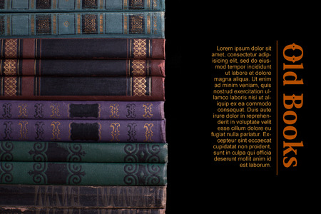 compiled: Decrepit old vintage book compiled in a row on a black background Stock Photo