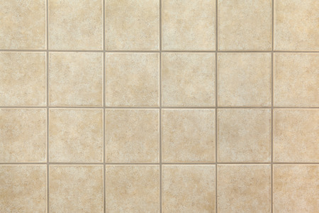 Beige ceramic tiles on the wall. Design background. Stock Photo