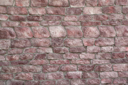 ragged: Wall texture from the old ragged red stone lined rows Stock Photo