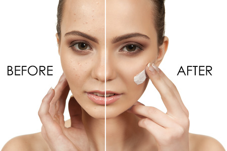 The beautiful girl with a make-up in Spa salon after cosmetic procedures holding a tool for makeup Standard-Bild
