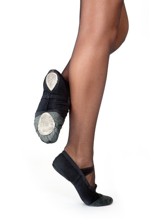 gym shoes: The initial position of the feet in the dance. Female feet in gym shoes on a white background.
