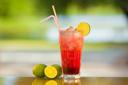 lemon wedge: Soft drink and fruit.