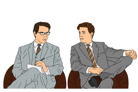 Two young male businessmen in classic suits are sitting at the conference in armchairs and talking.
