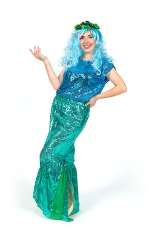 Girl actor dressed as a mermaid with blue hair. The figure is isolated on a white background.