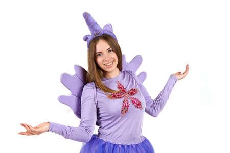 Girl in a purple unicorn costume in the studio on a white background.
