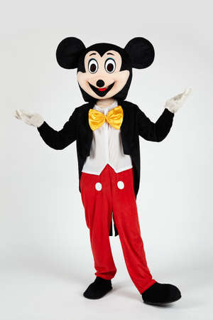 Mickey Mouse Isolated A photo of an actor dressed in a suit in the studio.