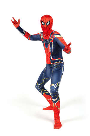 An actor disguised as a Spiderman costume in the studio against a white background, Belarus, July, 2021.