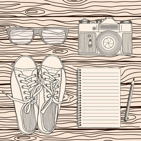 A set of accessories for the traveler photographer on the background of wooden boards. Vector illustration on a beige background. Иллюстрация