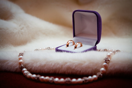 path to wealth: Wedding golden rings in the box and necklace