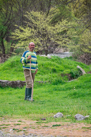 herdsman: Bulgarian herdsman on field - 09-04-2016 - Bistrets, Bulgaria Editorial