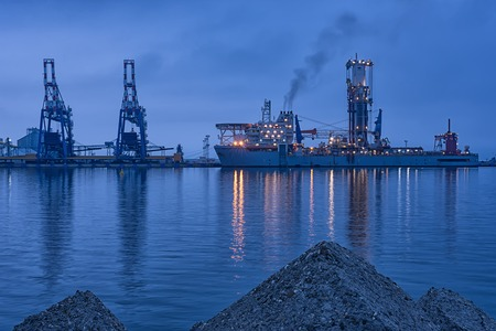 'rock drill': NOBLE GLOBETROTTER II - Drill ship Beautiful sunrise at Port of Burgas, Bulgaria Stock Photo