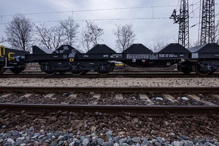 buffers: Burgas, Bulgaria - January 24, 2017 - Freight cargo train - 6-axled flat wagon - Sahmmn - WW 604 A- Transvagon AD Editorial