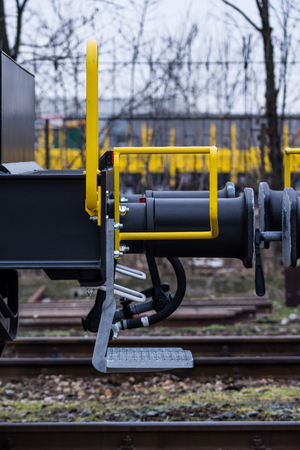 buffers: Burgas, Bulgaria - January 24, 2017 - Stairs- Freight cargo train - 6-axled flat wagon - Sahmmn - WW 604 A- Transvagon AD