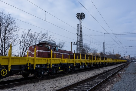 buffers: Burgas, Bulgaria - January 27, 2017 - Freight cargo train - 4-axled flat wagon Type:Res Model:072-2 - Transvagon AD Editorial