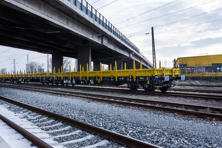 Burgas, Bulgaria - January 27, 2017 - Freight cargo train - 4-axled flat wagon Type:Res Model:072-2 - Transvagon AD Editorial