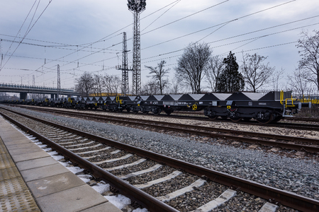 buffers: Burgas, Bulgaria - January 24, 2017 - Freight cargo train - 6-axled flat wagon - Sahmmn - WW 604 A- Transvagon AD Stock Photo