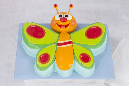 fondant fancy: Baby TV Colorful Butterfly Cake for Birthday Party