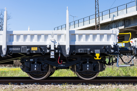 buffers: Burgas, Bulgaria - March 20, 2017 - Freight cargo train - 4axled flat wagon Type:Rens Model:192, B - Transvagon AD