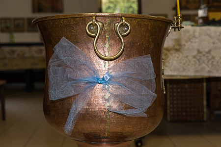 Christening Baptismal Font filled with Holy Water at the church before the ceremony