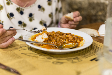 A Lady Eats A Tripe Dish At The Restaurant