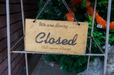 not open: Close-up Retro Wooden Sign We are Sorry Closed Please Call me agian Memo to all Customer Remind Stock Photo