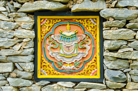 Bhutan Art  Carve on the Stone Wall Stock Photo