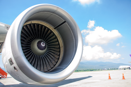 Close Up of Aeroplane Engine with Moutain and Sky Blue Background.Aeroplane Engine is key to make Aeroplane can fly.The Number on the Fan Make Engineering easy to Check for Safety. Stock Photo