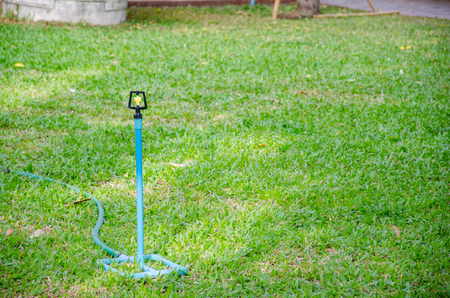 Automatic Sprinkler System on the Green Grass use for Comfortable Life.