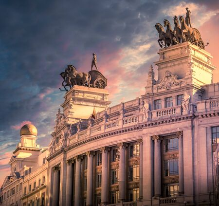 Quadriga in the top of an emblematic building in Madrid Imagens