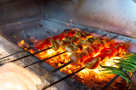 grill of meat and vegetables with hot coals