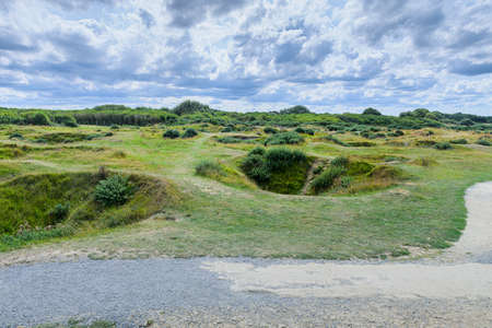 It is an area located on the top of a cliff on the Normandy coast, view of the vegetation the craters of the bombardment Banque d'images