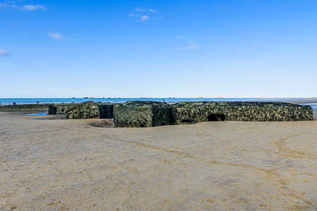 View of the surroundings on a sunny day, with remains of the platforms used in the Normandy landing. Stock Photo