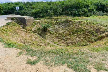 It is an area located on the top of a cliff on the Normandy coast, view of the vegetation the craters of the bombardment
