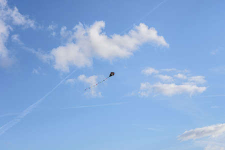 toy floating in the blue sky with some white clouds Banque d'images
