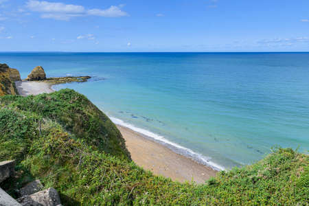 It is an area located on the top of a cliff on the Normandy coast, on a sunny day.