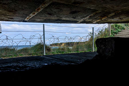 It is an area located on the top of a cliff on the Normandy coast, view from inside a bunker