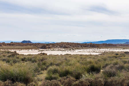 view of the semi-desert landscape on a sunny day with clouds.
