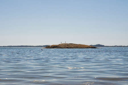 view of the small island and backlit youth