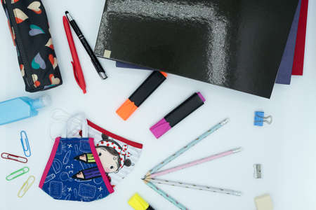 notebooks, pencils, various school supplies, masks and hydroalcoholic gel