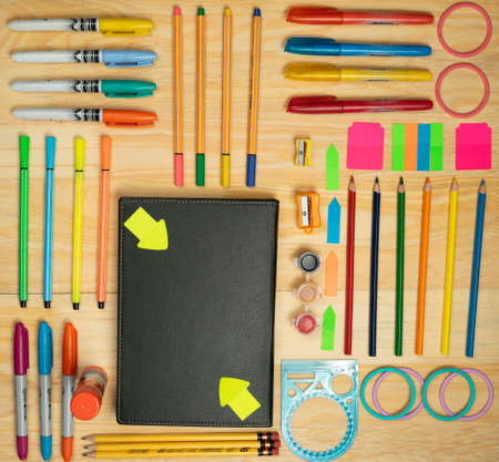 Pencils and utensils for drawing and working at home, with different colors and space to include texts.