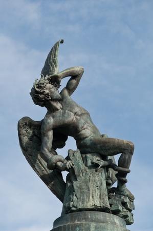 Statue of the Fallen Angel in Retiro Park, Madrid, Spain photo