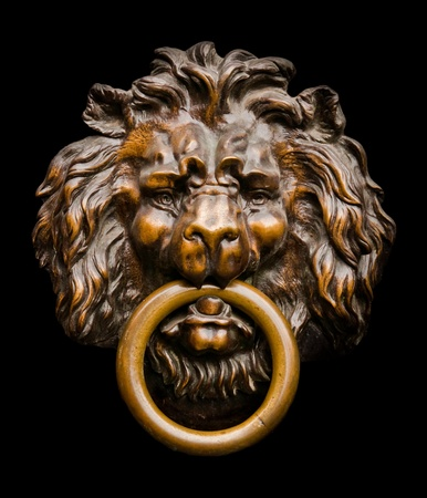 Close up of an isolated lion-shaped door knocker photo