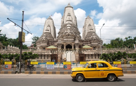 View of Birla Mandir and a taxi passing by in Calcutta, India