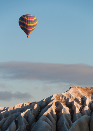 Ballon flying over Cappadocia mountain in winter. photo
