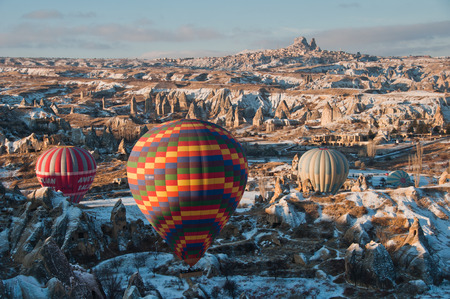 Colourfull balloon taking off at sunset in Cappadocia, Turkey photo
