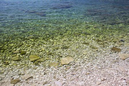 small stones: Sea wallpaper with small stones Stock Photo
