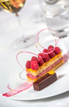Delicious gourmet dessert on dish photo