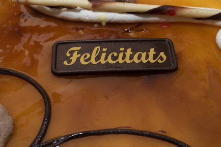 Birthday congratulation cake, anniversary, celebration. decorated with chocolate, cream, cream, and chocolate greeting plate